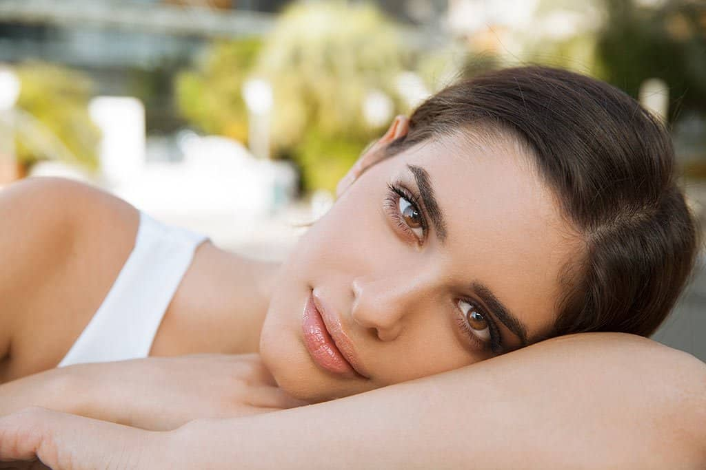 Women with smooth skin after dermaplaning