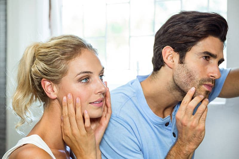 Couple with clear skin after Acne Treatments.